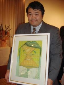 2007年NCN浅草大会で、小河原さんに描いてもらった似顔絵とともに。