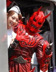"Akiyama and  ""Kamen Rider"" character"