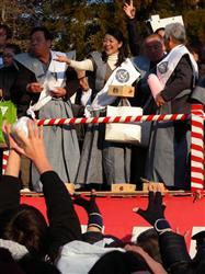 Michiko Hada throwing beans to ward off evil